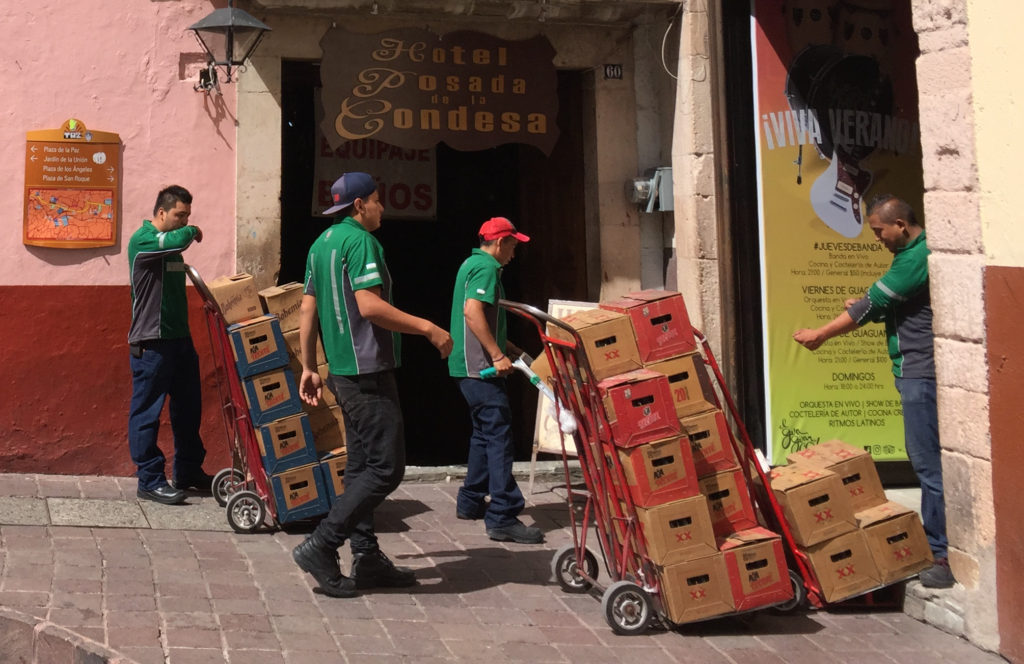 Men delivering Tecate, XX and Bohemia beer, Plaza de la Paz, Guanajuato